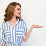 woman-in-blue-and-white-striped-top-raising-her-left-hand-1462637