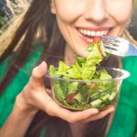 Portrait,Of,Attractive,Caucasian,Smiling,Woman,Eating,Salad,,Focus,On